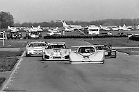 Bob Tullius navigates traffic around the Sebring airport circuit in the Jaguar XJR-5 in 1985. Tullius and co-driver Chip Robinson finished 4th in the race.