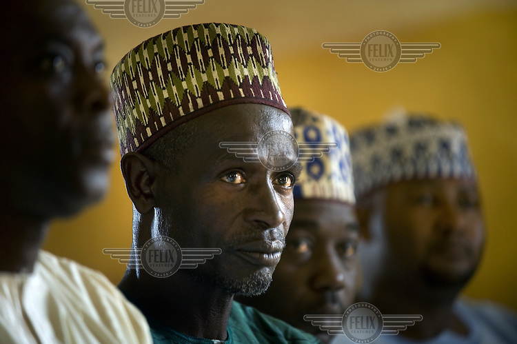 Men listening to a speech at the Central Mosque in Jos.