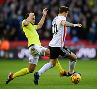 Sheffield United's Billy Sharp is tackled by Blackburn Rovers' Elliott Bennett<br /> <br /> Photographer Chris Vaughan/CameraSport<br /> <br /> The EFL Sky Bet Championship - Sheffield United v Blackburn Rovers - Saturday 29th December 2018 - Bramall Lane - Sheffield<br /> <br /> World Copyright © 2018 CameraSport. All rights reserved. 43 Linden Ave. Countesthorpe. Leicester. England. LE8 5PG - Tel: +44 (0) 116 277 4147 - admin@camerasport.com - www.camerasport.com