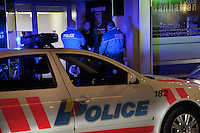 "Switzerland. Geneva. Two police officers arrest a man on the Berne street in the heart of the Paquis neighborhood, known for its nightlife and Red-light district. The policemen have stopped the man while driving under the influence of alcohol. Driving under the influence (DUI), drunken driving, drunk driving, drink driving, operating under the influence, drinking and driving, or impaired driving is the act of driving a motor vehicle with blood levels of alcohol in excess of a legal limit (""Blood Alcohol Content"", or ""BAC""). Both policemen are wearing a ballistic vest, bulletproof vest or bullet-resistant vest which is an item of personal armor that helps absorb the impact from knives, firearm-fired projectiles and shrapnel from explosions, and is worn on the torso. Soft vests are made from many layers of woven or laminated fibers and can be capable of protecting the wearer from small-caliber handgun and shotgun projectiles. 01.04.12 © 2012 Didier Ruef"
