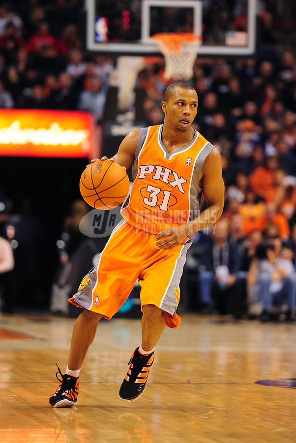 Dec. 26, 2011; Phoenix, AZ, USA; Phoenix Suns guard Sebastian Telfair controls the ball during game against the New Orleans Hornets at the US Airways Center. The Hornets defeated the Suns 85-84. Mandatory Credit: Mark J. Rebilas-USA TODAY Sports