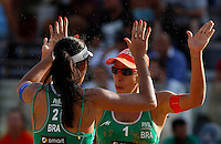 Brazil's Talita Antunes and Taiana Lima, right, celebrate at the Beach Volleyball World Tour Grand Slam, Foro Italico, Rome, 21 June 2013.<br /> UPDATE IMAGES PRESS/Isabella Bonotto