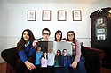 Siobhan McLaughlin (2nd right) with her 3 out her 4 children Rebecca, Billy and Lisa as they hold a photo of their late father John Adams. Siobhan is bringing a case to the supreme court about the rights of unmarried widows. Photo/Paul McErlane
