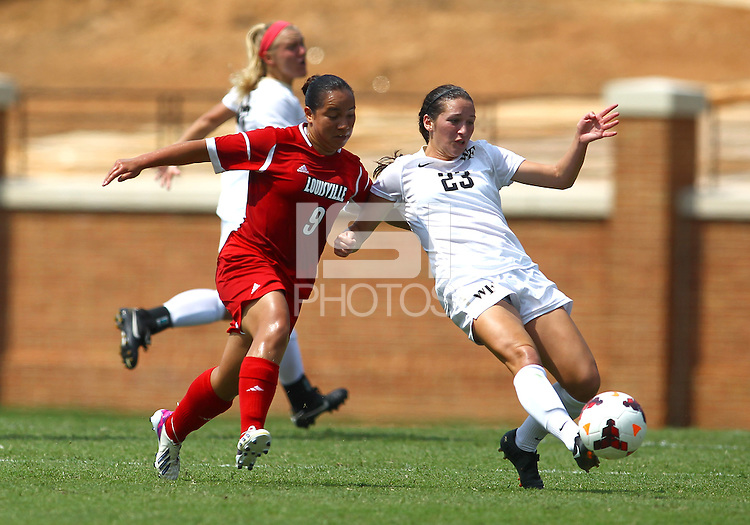 WINSTON-SALEM, NORTH CAROLINA - September 01, 2013:<br /> Charlyn Corral (9) of Louisville University pushes into the back of Kendall Fischlein (23) of Wake Forest University during a match at the Wake Forest Invitational tournament at Wake Forest University on September 01. The match was abandoned early in the second half due to severe weather with Wake leading 1-0.