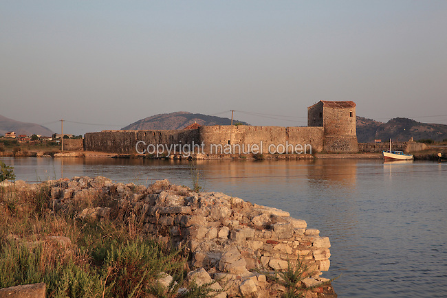 Triangular Fortress, built by the Venetians in late 15th - early 16th century, Butrint, Chaonia, Albania. The venetians re-fortified Butrint to protect their valuable mainland resources, first building the Triangular fortress and then massive square blockhouse, known now as the Venetian Tower. Venice capitulated to Napoleon Bonaparte in 1797, when Butrint fell into the hands of the infamous local despot Ali Pasha of Tepelena. Butrint was founded by the Greek Chaonian tribe and was a port throughout Hellenistic and Roman times, when it was known as Buthrotum. It was ruled by the Byzantines and the Venetians and finally abandoned in the Middle Ages. The ruins at Butrint were listed as a UNESCO World Heritage Site in 1992. Picture by Manuel Cohen