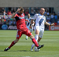 Chicago defender Arne Friedrich (23) blocks a kick by LA Galaxy forward Chad Barrett (9).  The LA Galaxy defeated the Chicago Fire 2-0 at Toyota Park in Bridgeview, IL on July 8, 2012.