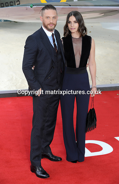 NON EXCLUSIVE PICTURE: MATRIXPICTURES.CO.UK<br /> PLEASE CREDIT ALL USES<br /> <br /> WORLD RIGHTS<br /> <br /> English actor Tom Hardy and English actress Charlotte Riley attend the World Premiere of Dunkirk at Odeon Leicester Square in London.<br /> <br /> JULY 13th 2017<br /> <br /> REF: TST 171544