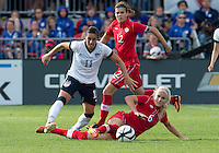 02 June 2013: U.S .Women's National Team player Ali Krieger #11 battles with Canadian Women's Nation Team player Kayln Kyle #6 during an international friendly soccer match between the U.S Women's National Team and the Canadian Women's National Team at BMO Field in Toronto, Ontario Canada.<br /> The U.S. National Women's Team won 3-0.