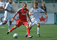 06 June 2009: Toronto FC midfielder Dewayne DeRosario #14 and Los Angeles Galaxy midfielder Mike Magee #18 in  MLS action at BMO Field Toronto in a game between LA Galaxy and Toronto FC. .The Galaxy  won 2-1.