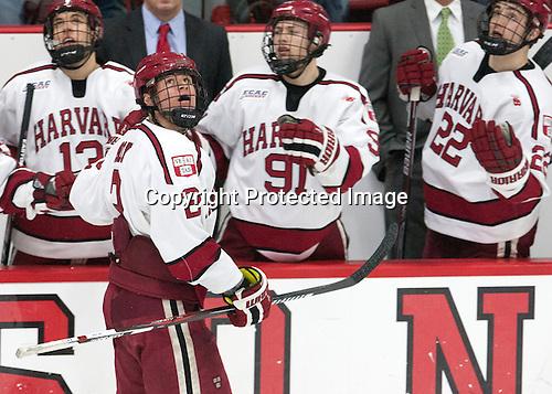 Tyler Moy (Harvard - 2) watches the replay of his goal. -  - The Harvard University Crimson defeated the visiting Colgate University Raiders 7-4 (EN) on Saturday, February 20, 2016, at Bright-Landry Hockey Center in Boston, Massachusetts.