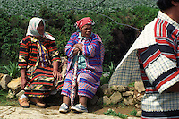 """Ibaloy women welcoming the mummy """"Apo Anno."""" Ibaloys are one of the ethno-linguistic groups residing in the Philippine Cordillera at the northeastern part of main island of Luzon, Philippines. Natubleng, Benguet. May, 1999"""