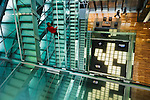 _DSC2307, Vacheron, Geneva, Switzerland, 01/2016, SWITZERLAND-10031. Woman in red walks up stairs.<br /> <br /> CHECK IMAGE USAGE<br /> <br /> FINAL_Vacheron<br /> <br /> retouched_Sonny Fabbri and Ekaterina Savtsova 06/09/2016