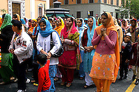 """Rome April 30 2006  .Piazza Vittorio  .Sikh """"Punj Pyare"""" (Five Beloved Ones) lead a religious parade.The parade is for Visaki, a traditional Sikh celebration..Women and Sikh children in procession."""