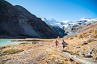 Trail running at the Lej da Vadret, an alpine lake in the Rosegtal above Pontresina, Switzerland