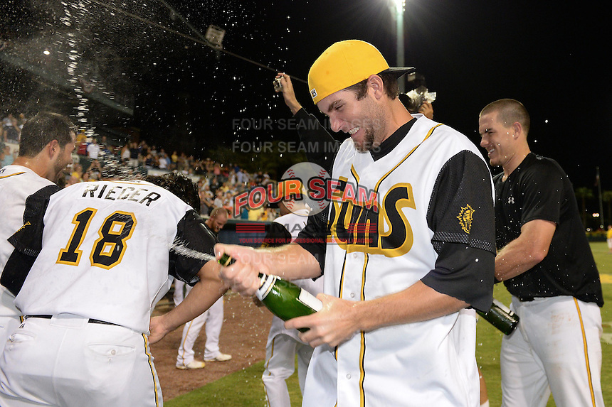 Jacksonville Suns pitcher Trevor Williams (9) celebrates after game three of the Southern League Championship Series against the Chattanooga Lookouts on September 12, 2014 at Bragan Field in Jacksonville, Florida.  Jacksonville defeated Chattanooga 6-1 to sweep three games to none.  (Mike Janes/Four Seam Images)