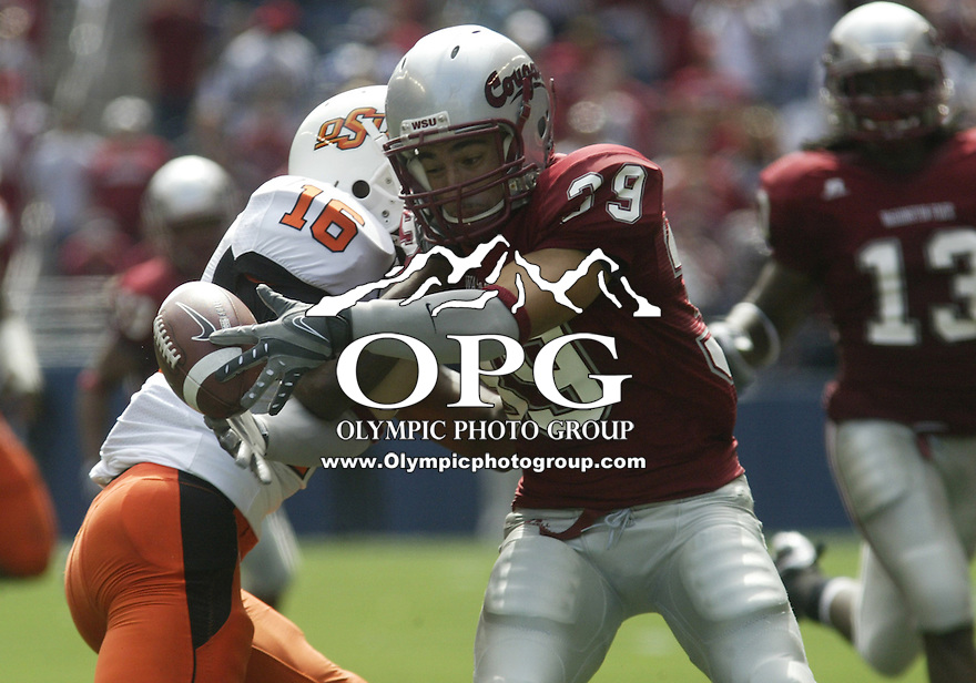 August 30, 2008: Washington State special teams player #39 Tali Talakai downs the punted ball before Oklahoma States #16 Perrish Cox can get it.  Oklahoma State won 39-13 over Washington State at Quest Field in Seattle, Washington.