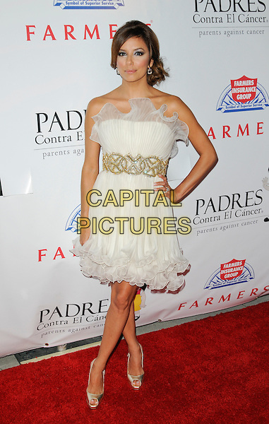EVA LONGORIA PARKER .arriving at the Padres Contra El Cancer 9th Annual El Sueno De Esperanza Benefit Gala at the Hollywood Palladium in Hollywood, California, USA, September 10th 2009..full length strapless white cream dress gold waistband hand on hip shoes heels ruffle hem tulle platform slingbacks .CAP/ROT.©Lee Roth/Capital Pictures.
