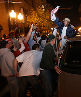 St. Louis Cardinal fans share cheers with passing cars on second street in Laclede's Landing after the St. Louis Cardinals won the World Series against the Detroit Tigers on Friday, October 27, 2006.