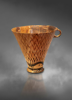 Minoan clay cup decorated with reeds, Zakros Palace  1600-1450 BC; Heraklion Archaeological  Museum, grey background.