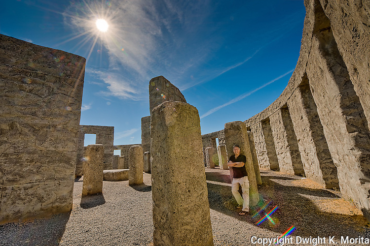 Sunburst accents the blue skies over the Stonehenge Memorial in Maryhill, Washington built by Samuel Hill. Photographer in a self-portrait