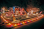 Christmas lights at 110 Copper Run, Madison, AL.  Features lots of lights not only on house and throughout yard but rows of lights on the yard.  Bob Gathany photo.