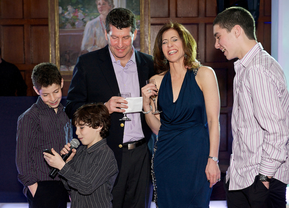 Younger brother toasting the Bar Mitzvah boy cracking mom up.