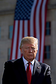 United States President Donald J. Trump pauses during a ceremony to commemorate the September 11, 2001 terrorist attacks, at the Pentagon in Washington, D.C., U.S., on Monday, Sept. 11, 2017. Trump is presiding over his first 9/11 commemoration on the 16th anniversary of the terrorist attacks that killed nearly 3,000 people when hijackers flew commercial airplanes into New York's World Trade Center, the Pentagon and a field near Shanksville, Pennsylvania. <br /> Credit: Andrew Harrer / Pool via CNP