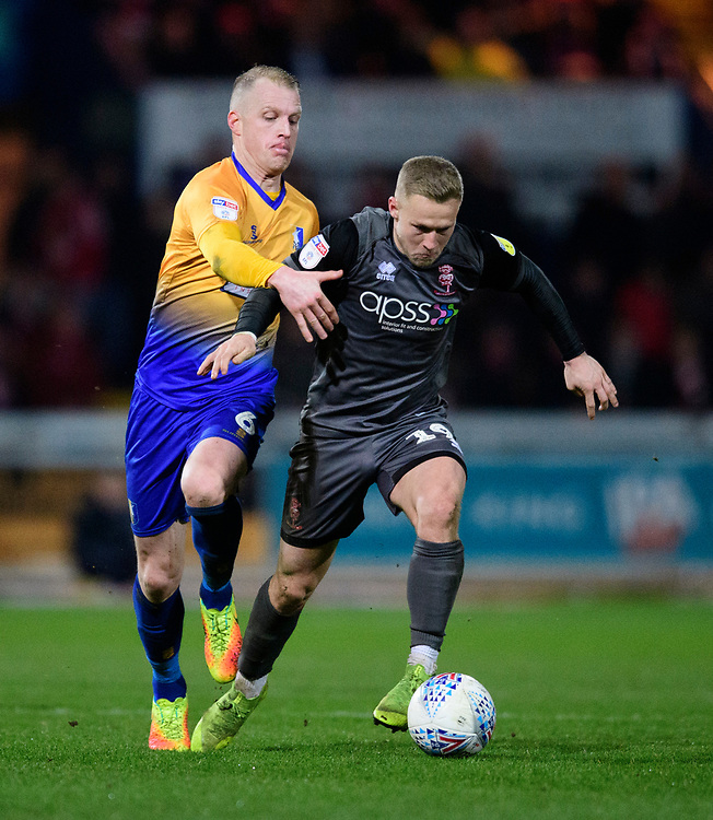 Lincoln City's Danny Rowe vies for possession with Mansfield Town's Neal Bishop<br /> <br /> Photographer Chris Vaughan/CameraSport<br /> <br /> The EFL Sky Bet League Two - Mansfield Town v Lincoln City - Monday 18th March 2019 - Field Mill - Mansfield<br /> <br /> World Copyright © 2019 CameraSport. All rights reserved. 43 Linden Ave. Countesthorpe. Leicester. England. LE8 5PG - Tel: +44 (0) 116 277 4147 - admin@camerasport.com - www.camerasport.com