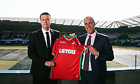 Pictured L-R: Paul Fox, CEO of Letou with Chris Pearlman, COO of Swansea City FC. Monday 19 June 2017<br /> Re: Swansea City FC launch their new home and away kits and announce Letou as their new sponsor at the Liberty Stadium, Swansea, Wales, UK.