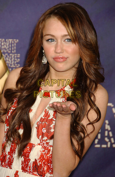 MILEY CYRUS .2008 CMT Music Awards held at Curb Events Center at Belmont University, Nashville, Tennessee, USA, .14 April 2008..portrait headshot red and cream print silver earrings hand .CAP/ADM/LF.©Laura Farr/Admedia/Capital PIctures