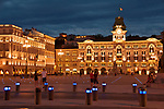 Piazza Unita d'Italia at night, with City Hall in the background in Trieste, Italy
