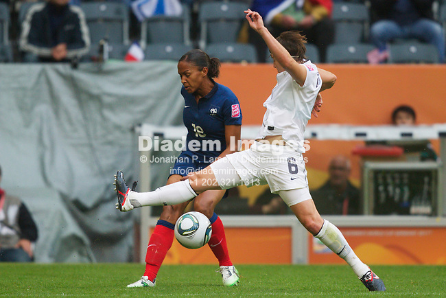 MOENCHENGLADBACH, GERMANY - JULY 13:  Amy LePeilbet of the United States (R) defends against Marie-Laure Delie of France (L) during a FIFA Women's World Cup semifinal match at Stadion im Borussia Park on July 13, 2011  in Moenchengladbach, Germany.  Editorial use only.  Commercial use prohibited.  No push to mobile device usage.  (Photograph by Jonathan P. Larsen)
