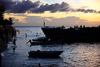TANZANIA Zanzibar, Stone town, evening at sea, tanzanian navy ship / TANSANIA Insel Sansibar, Stonetown, abends am Meer, Schiff der tansanischen Marine
