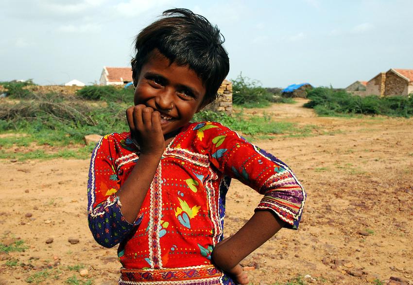 Girl in village at the desert's edge..Michael Benanav - mbenanav@gmail.com