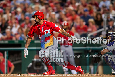 29 July 2017: Washington Nationals outfielder Howie Kendrick hits a double in the 6th inning in his first at-bat in a Nationals uniform, against the Colorado Rockies at Nationals Park in Washington, DC. The Rockies defeated the Nationals 4-2 in the first game of their 3-game weekend series. Mandatory Credit: Ed Wolfstein Photo *** RAW (NEF) Image File Available ***