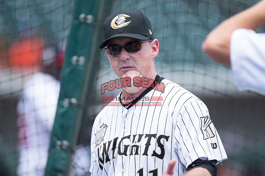 Charlotte Knights hitting coach Andy Tomberlin (11) watches the International League team take batting practice on Media Day for the 2016 Triple-A All-Star Game at BB&T BallPark on July 12, 2016 in Charlotte, North Carolina.   (Brian Westerholt/Four Seam Images)