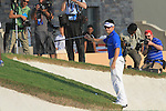 Louis Oosthuizen has an awkward chip at the 18th green during the Final Day of the Dubai World Championship, Earth Course, Jumeirah Golf Estates, Dubai, 28th November 2010..(Picture Eoin Clarke/www.golffile.ie)