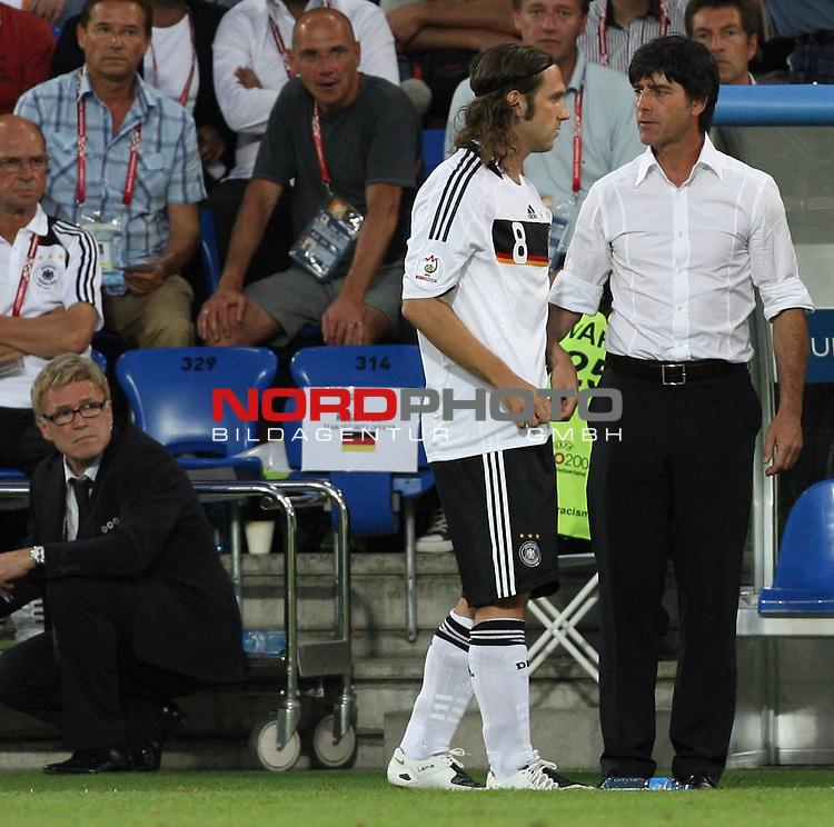 UEFA Euro 2008 Semi-Finals Match 29 Basel - St. Jakob-Park. Deutschland ( GER ) - T&uuml;rkei ( TUR ) 3:2 ( 1:1 ). <br /> Joachim Loew (L&ouml;w) - ( Germany / Trainer / Coach ) (r) im Gespr&auml;ch mit Torsten Frings ( Germany / Mittelfeldspieler / Midfielder / Werder Bremen #08 ) (M). Spielebeobachter Urs Siegenthaler (l) schaut zu.<br /> Foto &copy; nph (  nordphoto  )