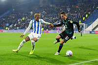 Juninho Bacuna of Huddersfield Town battles with Kristoffer Peterson of Swansea City during the Sky Bet Championship match between Huddersfield Town and Swansea City at The John Smith's Stadium in Huddersfield, England, UK. Tuesday 26 November 2019