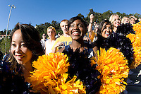 California cheerleaders welcome California football players walking up on the stairs to the stadium before the game against Northwestern at Memorial Stadium in Berkeley, California on August 31st, 2013.  Northwestern defeated CAL, 44-30.