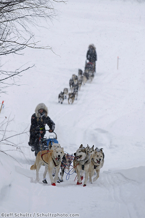 Kristi Berington leads her twin sister Anna up the bank from the Takotna River into the Takotna checkpoint Wednesday March 6, 2013...Iditarod Sled Dog Race 2013..Photo by Jeff Schultz copyright 2013 DO NOT REPRODUCE WITHOUT PERMISSION
