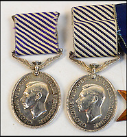 BNPS.co.uk (01202 558833)<br /> Pic: AdamPartridge/BNPS<br /> <br /> The Distinguished Flying Medals of Sergeants Denys Chapman and Kenneth Leach.<br /> <br /> The little-known story of a heroic Second World War pilot and navigator duo who were the real life version of Maverick and Goose from 80s film Top Gun has emerged after more than 70 years.<br /> <br /> Sergeants Denys Chapman and Kenneth Leach were both awarded a Distinguished Flying Medal - one of the air force's top awards - for their bravery fighting enemy aircraft in the 1940s.<br /> <br /> Unusually, Sergeant Leach got his when Command tried to give a second DFM to Sgt Chapman but he refused and insisted it go to his flying buddy for saving his life. <br /> <br /> The rare and important medals are now going up for sale together with Adam Partridge Auctioneers in Macclesfield, Cheshire.