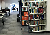 NWA Democrat-Gazette/ANDY SHUPE<br />Books fill shelving Saturday, March 17, 2018, in Mullins Library on the University of Arkansas campus in Fayetteville. Planned renovations to the library call for roughly 75 percent of printed books to be moved to storage off campus, following a trend of removing printed materials from libraries to make room for study and research areas.