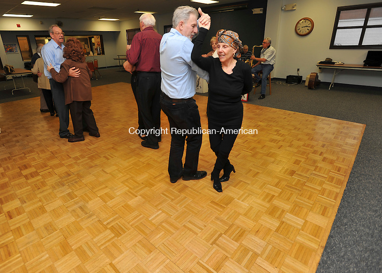 TORRINGTON, CT-21 APRIL 2010-042110IP02-    Joyce Kang and Richard Sanford, both of Bristol, dance to the sounds of local band The Four Seasons during a music and dancing program at the Sullivan Senior Center in Torrington on Wednesday. <br /> Irena Pastorello Republican-American