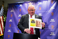 NWA Democrat-Gazette/CHARLIE KAIJO Chief of Police Hayes Minor holds up a picture of Grant Horton, suspect in a cold case during a press conference, Monday, February 12, 2018 at the Rogers Police Station in Rogers. <br />