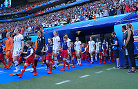 DECINES-CHARPIEU, FRANCE - JULY 07: USA starting eleven walk out during the 2019 FIFA Women's World Cup France Final match between Netherlands and the United States at Groupama Stadium on July 07, 2019 in Decines-Charpieu, France.
