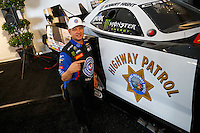 Feb 8, 2017; Pomona, CA, USA; NHRA funny car driver Robert Hight poses with California Highway Patrol themed car during media day at Auto Club Raceway at Pomona. Mandatory Credit: Mark J. Rebilas-USA TODAY Sports