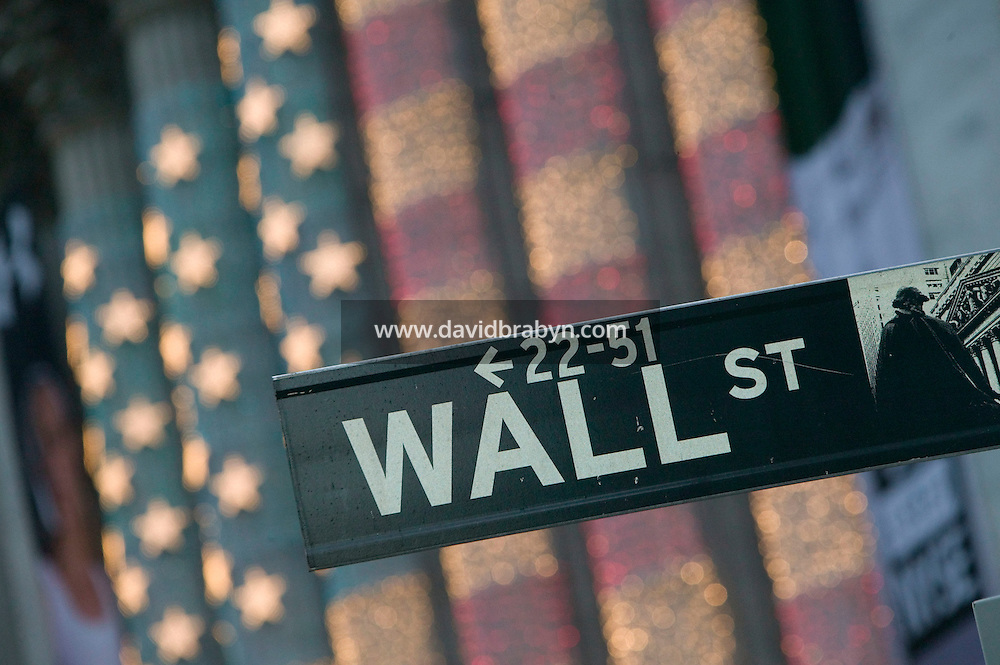18 December 2006 - New York City, NY - View of a Wall Street sign in front of the New York Stock Exchange façade in the financial district of Manhattan in New York City, NY, 18 December 2006.