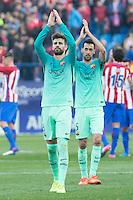 Gerard Pique and Sergio Busquets of Futbol Club Barcelona during the match of Spanish La Liga between Atletico de Madrid and Futbol Club Barcelona at Vicente Calderon Stadium in Madrid, Spain. February 26, 2017. (Rodrigo Jimenez / ALTERPHOTOS) /NortEPhoto.com