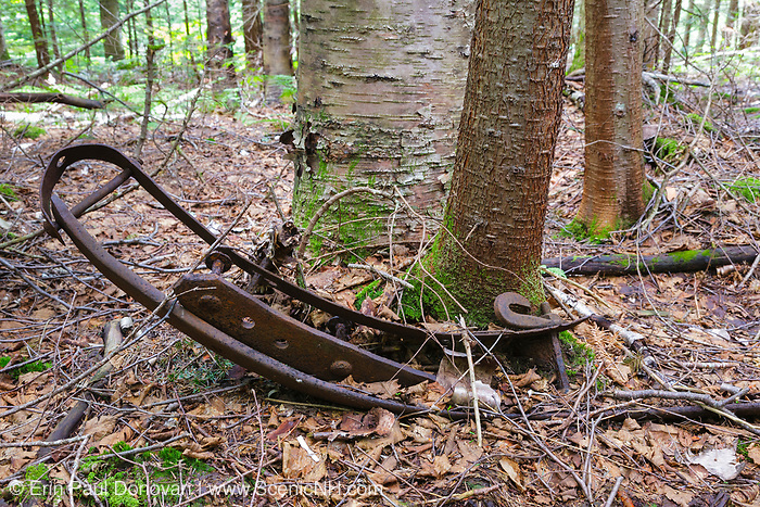 Artifact (sled runner) at the Old Johnson Camp in the Pemigewasset Wilderness, New Hampshire. This camp, owned by the Johnson Lumber Company (Gordon Pond Railroad), was located on the side of Mount Liberty in the Liberty Brook drainage of the Pemigewasset Wilderness. The Johnson Lumber Company owned a stand of spruce on the Pemigewasset Wilderness side of Mount Liberty, but they couldn't reach it from the Gordon Pond Railroad because the terrain was too steep and it was surrounded by land owned by the East Branch & Lincoln Railroad. George Johnson made a deal with James Henry to haul the timber out using the East Branch & Lincoln Railroad. The removal of historic artifacts from federal lands without a permit is a violation of federal law.